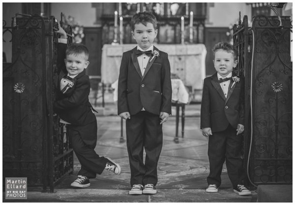 pageboy in suit and bow tie