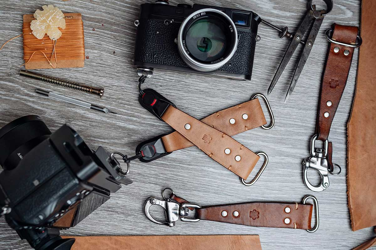 Leather camera harness hand made sliders with Peak Design clips. these are my new sliders for my DIY harness. Wedding photographer Martin Ellard My Big Day Photos