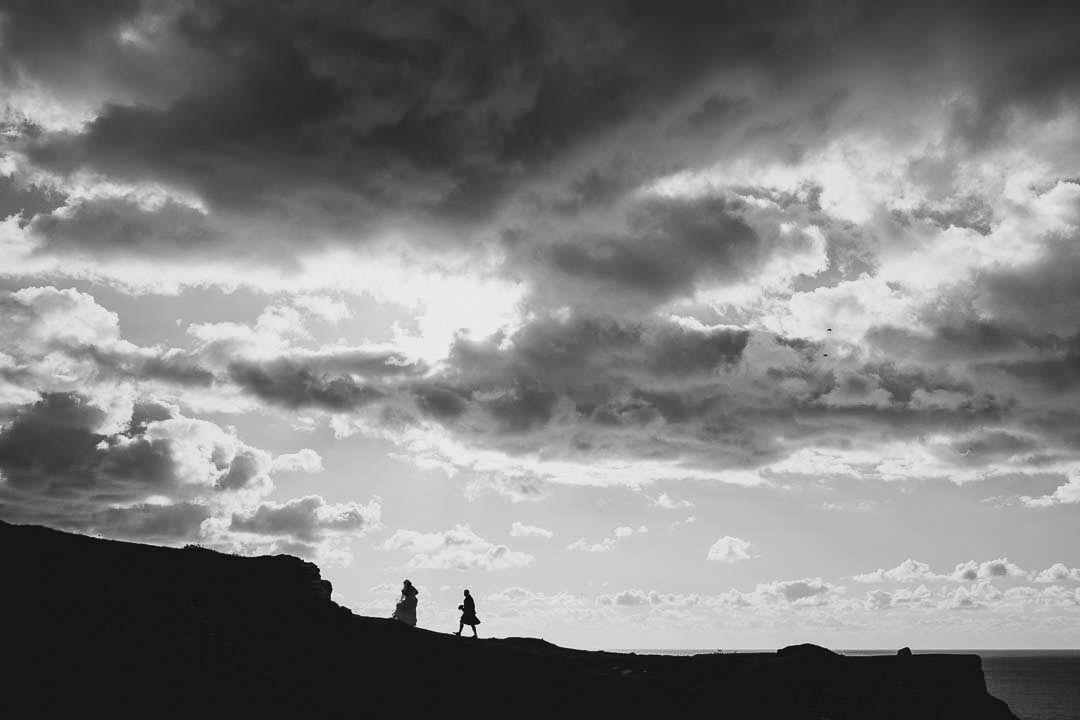 natural authentic wedding photo of a bride and groom on the cliffs at Rhossili in Gower