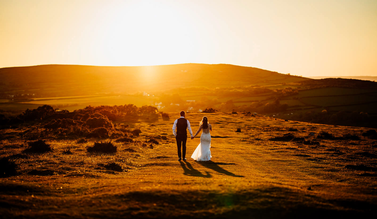 bride and groom walking towards the sunset in Gower, South Wales documentary wedding photographer 2019