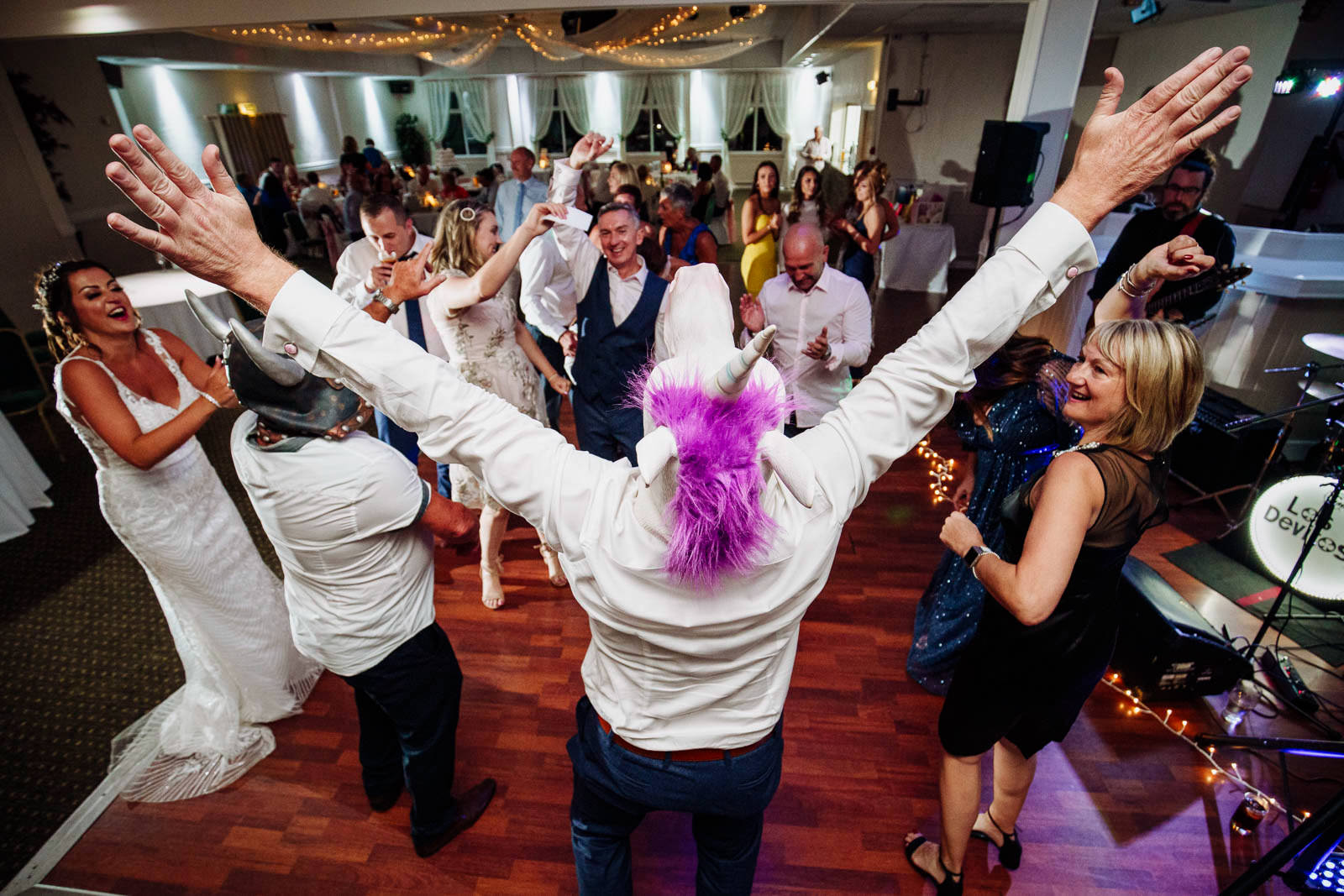 Best man dressed as a unicorn on the dance floor at a wedding in Swansea