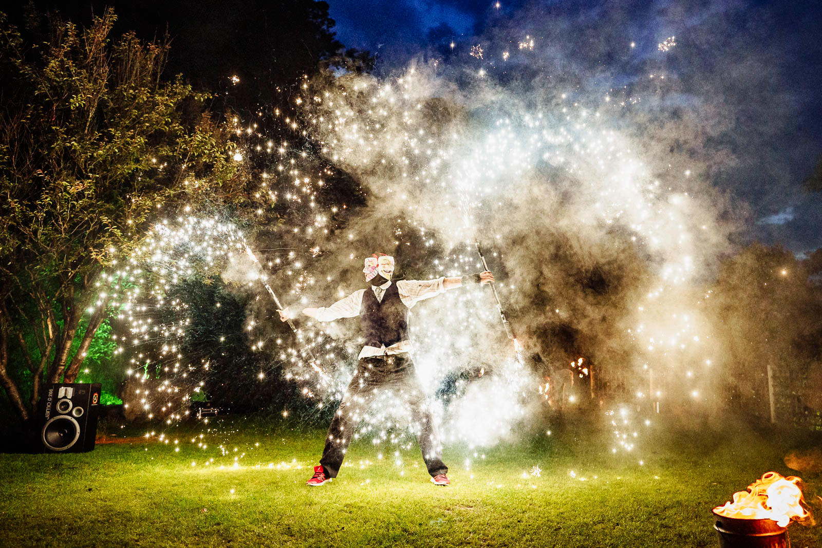 dramatic fire performer at an Oxwich Bay Hotel wedding Swansea South Wales