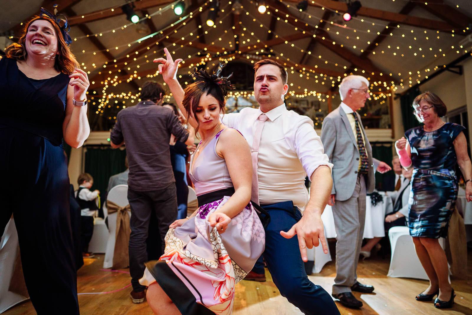 wedding guests dancing under fairylights at Mydffai community hall Llandovery documentary wedding photographer 2019
