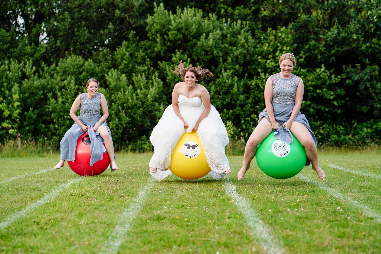 A bride and her bridesmaids race on spacehoppers at Rudry Parish Hall near Cardiff